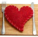 Coração vermelho com uma forquilha Foto de Stock Royalty Free