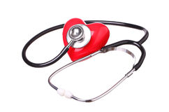Coração vermelho da verificação do estetoscópio isolado no fundo branco Imagens de Stock Royalty Free
