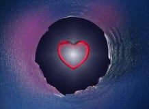 Coração vermelho do Valentim no furo de vidro Imagem de Stock Royalty Free