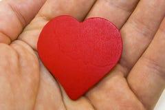 Coração vermelho na mão Foto de Stock Royalty Free