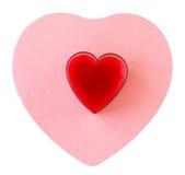 Coração vermelho no coração cor-de-rosa imagens de stock royalty free