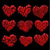 Coração vermelho quebrado no preto Fotografia de Stock