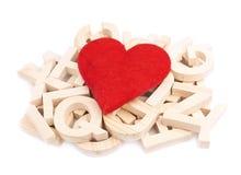 Coração vermelho sobre a pilha de letras de madeira Imagens de Stock Royalty Free
