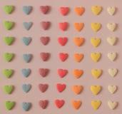 Corações coloridos dos doces fotografia de stock