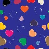Corações coloridos no fundo azul Fotos de Stock Royalty Free
