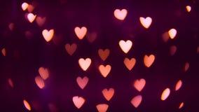 Corações conduzidos cor-de-rosa de surpresa Bokeh Valentine Day Background piscar 4K filme