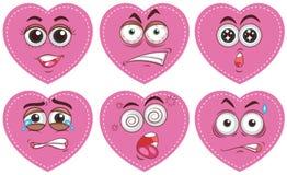 Corações cor-de-rosa com expressões diferentes ilustração royalty free
