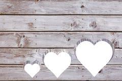 Corações cortados na madeira Imagem de Stock Royalty Free