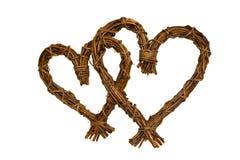 Corações de madeira isolados em um fundo branco Imagens de Stock