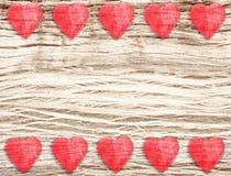 Corações de madeira no fundo suportado, espaço para o texto Foto de Stock Royalty Free