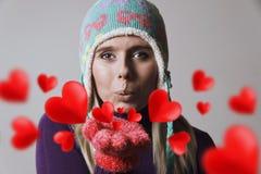 Corações de sopro da mulher imagem de stock royalty free