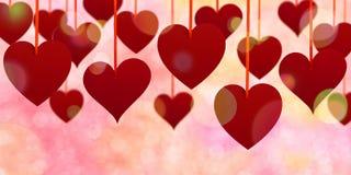 Corações de suspensão de Bokeh Foto de Stock