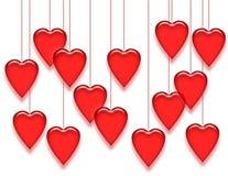 Corações de suspensão no branco Imagens de Stock Royalty Free