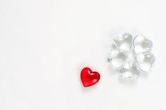 Corações de vidro no fundo branco Fotos de Stock