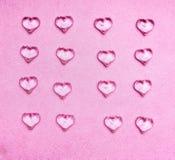Corações de vidro no fundo cor-de-rosa Fotos de Stock