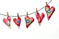Corações do amor na linha de lavagem Imagens de Stock