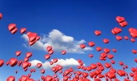 Corações do amor no céu azul Fotos de Stock Royalty Free