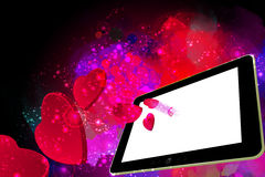 Corações do amor que saem de um PC da tabuleta Imagem de Stock