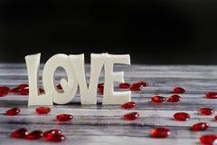Corações do rubi em torno do amor Imagem de Stock Royalty Free