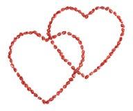 Corações do Valentim feitos de sementes da romã Foto de Stock Royalty Free