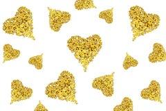 Corações dos grânulos dourados imagem de stock royalty free