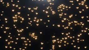 Corações dourados em um fundo preto Fotos de Stock Royalty Free