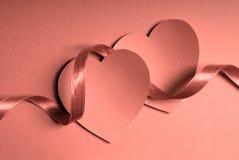 Corações e fita Imagem de Stock