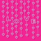 """Corações e letras """"LOVE"""" que penduram em cordas Imagens de Stock"""