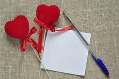 Corações e uma nota Foto de Stock Royalty Free