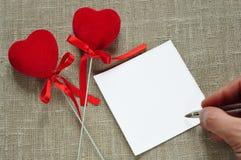 Corações e uma nota Fotografia de Stock