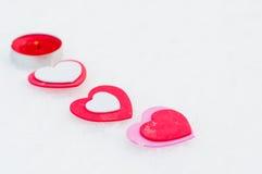 Corações e vela na neve Fotografia de Stock Royalty Free