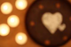 Corações e velas do borrão artístico Fotografia de Stock