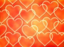 Corações em um fundo amarelo-alaranjado Símbolo do amor Fotos de Stock