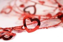 Corações em uma fileira Imagens de Stock