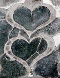 Corações em uma pedra Fotos de Stock