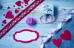Corações, flores, fitas Foto de Stock
