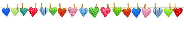 Corações na beira da corda Imagem de Stock