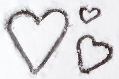 Corações na neve Foto de Stock Royalty Free