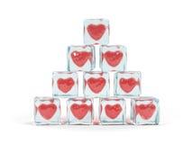 Corações no cubo de gelo Imagens de Stock Royalty Free