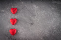Corações no fundo cinzento Foto de Stock