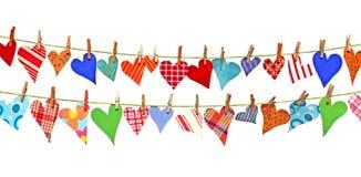 Corações que penduram em linhas Fotos de Stock Royalty Free