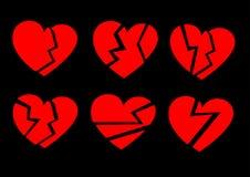 Corações quebrados vermelhos em um fundo preto Fotografia de Stock Royalty Free