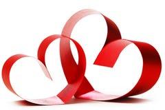 Corações vermelhos da curva da fita Imagem de Stock Royalty Free