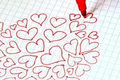 Corações vermelhos desenhados em uma folha Imagem de Stock Royalty Free