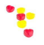 Corações vermelhos e amarelos dos doces Fotografia de Stock