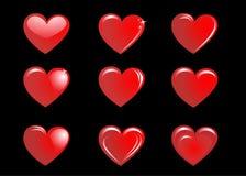Corações vermelhos em um fundo preto, coleção Imagens de Stock