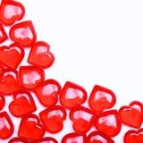 Corações vermelhos isolados no fundo branco com espaço para o texto. Foto de Stock