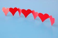 Corações vermelhos que mostram o amor imagem de stock
