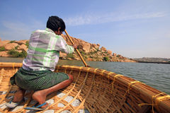 A coracle boatman in Hampi lake Royalty Free Stock Images