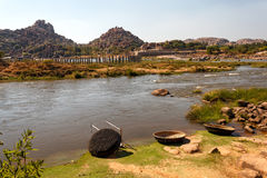 Coracle boats in Tungabhadra River, Hampi ruins, India Stock Photos